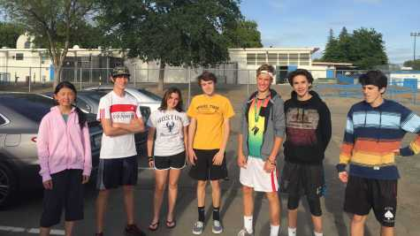 Freshman lacrosse player Ben Miner (second from right), who covers the tennis beat for the Octagon, joined the team for one match on April 26.