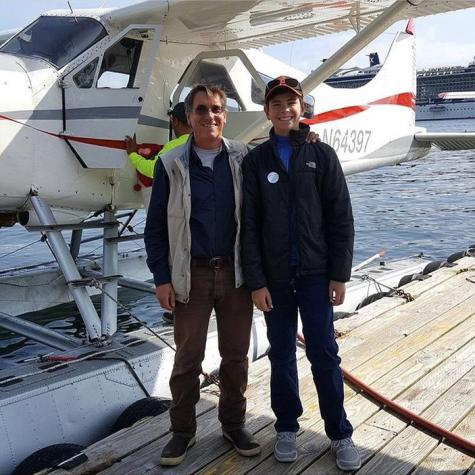 Freshman John Snyder with Tony, a sea plane pilot, during a trip to Alaska in July.