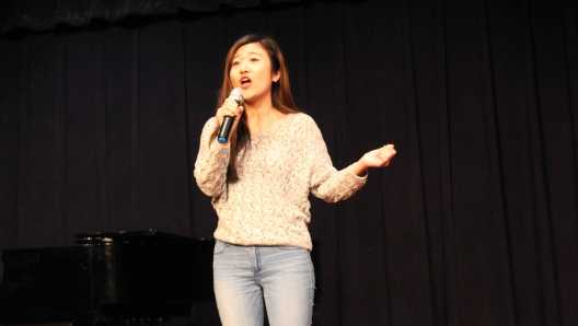 "Senior Michelle LI sings ""Fight Song"" at the Rockvemberfest variety show."
