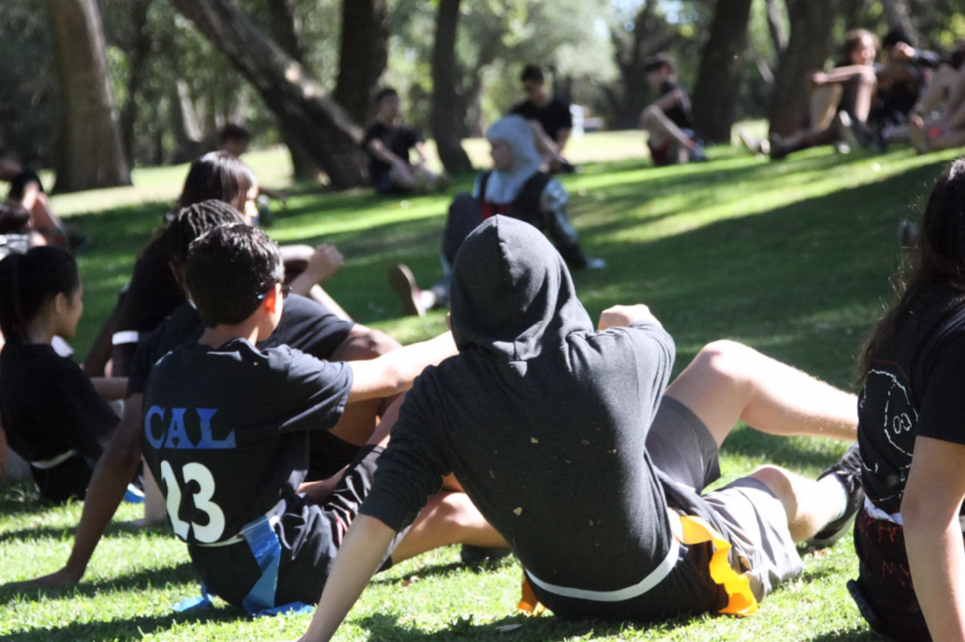 The Black Team stretches before the game. (Photo by Shimin Zhang)