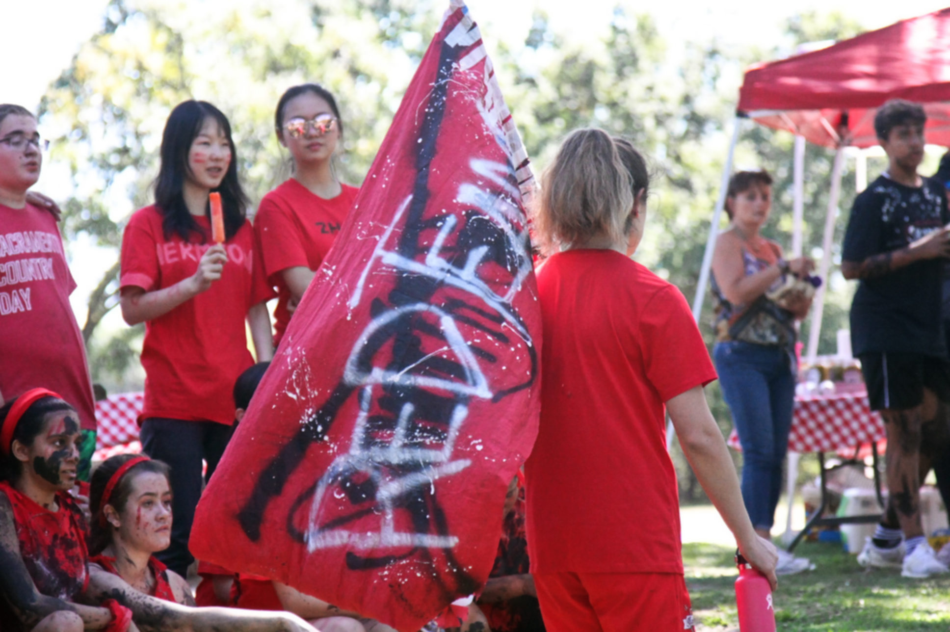 Junior Allie Bogetich carries the Red Team's flag. (Photo by Shimin Zhang)
