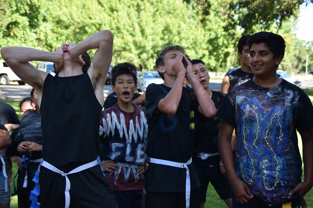 Senior Becca Waterson (not pictured) leads the Black Team in a cheer. (Photo by Maddie Woo)