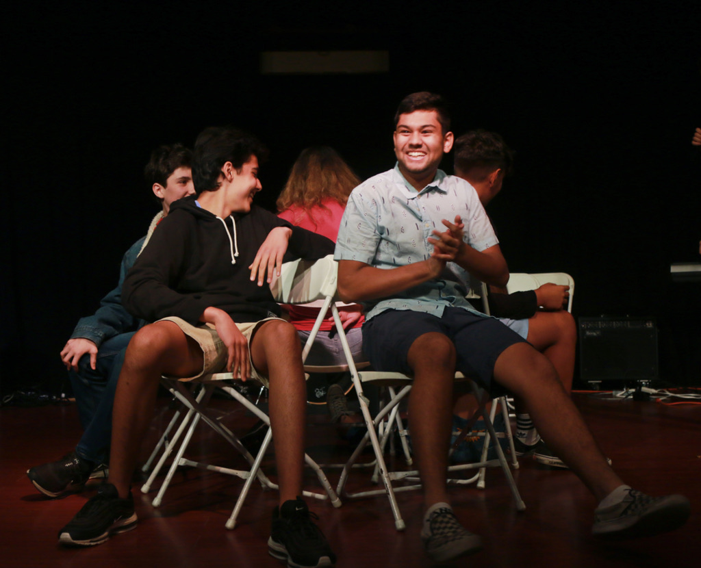 While the judges deliberate, students play musical chairs. Junior Avinash Krishna claps after advancing to the next round. (Photo by Hermione Xian)