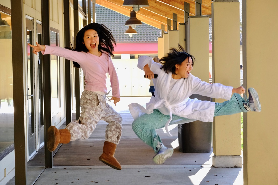 Posing in midair, seniors Yumi Moon and Maddie Woo show off their pajamas.
