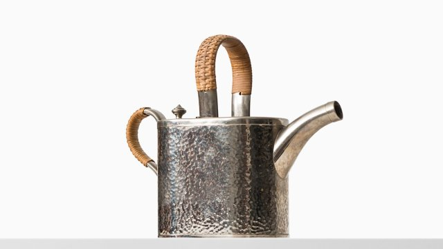 Teapot in metal and woven cane by Carl Deffner at Studio Schalling