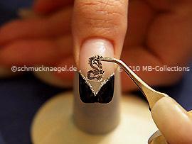 Dragon Nail Tattoo And Tweezers