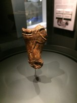 An aurochs carved in the round on a bone