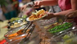 catering buffet food indoor in luxury restaurant with meat colorful fruits and vegetables