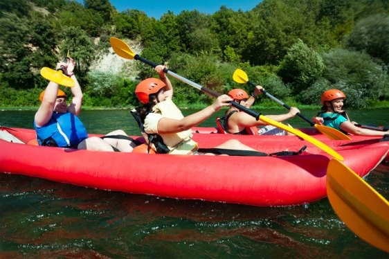 a group enjoys kayaking