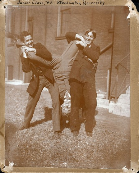 "Three juniors clown around on campus at Washington University. ""Junior Class, '93. Washington University,"" ca. 1893."