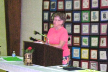 Suzanne Leopold, the Sappington House Foundation president, at the podium for fundraising luncheon on May 18, 2015.