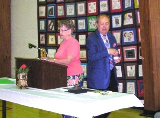 Suzanne Leopold, and Dr. John Oldani, at the podium for fundraising luncheon on May 18, 2015.