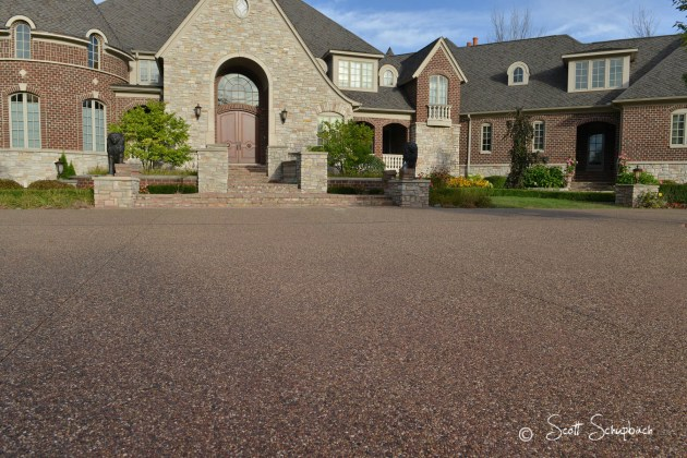 Exposed Peastone Aggregate with Coral Red integral color Peastone with Coral Red integral color Driveway