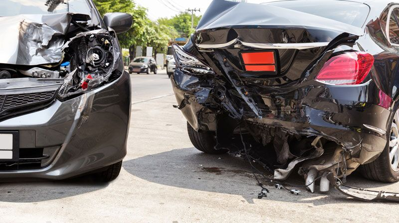 two badly damaged cars after an accident