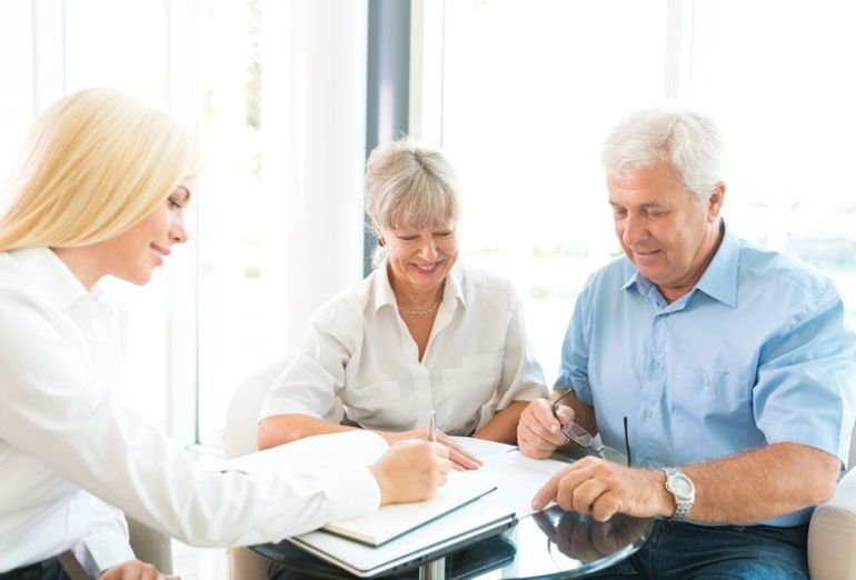 elderly couple looking at their life insurance policy