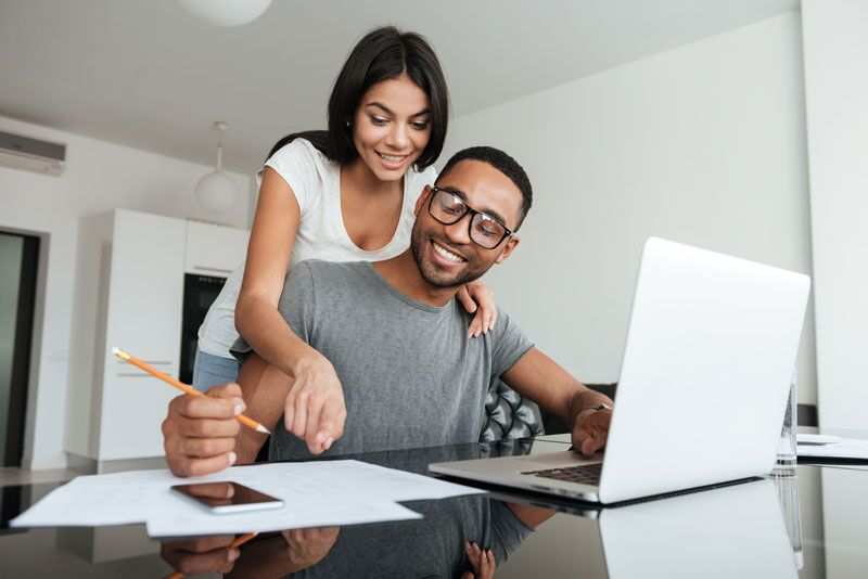 couple looking at car insurance on laptop
