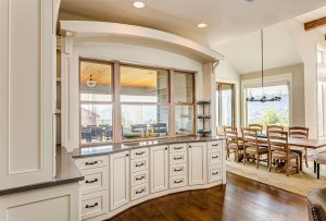 Kitchen Cabinets and Windows and Dining Room in New Luxury Home with window installation