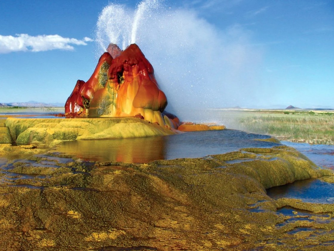 nevadas-fly-geyser-located-in-washoe-county-was-created-through-accidental-well-drilling-in-1916-in-the-1960s-the-water-began-escaping-from-the-drilled-location-creating-the-geyser-that-is-known-for-its-stunning-changing-colors
