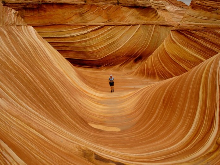 the-wave-is-a-sandstone-rock-formation-located-in-the-paria-canyon-vermillon-cliffs-wilderness-near-the-border-of-arizona-and-utah-its-known-for-its-colorful-and-unique-formations-and-the-difficult-hike-required-to-reach-it-and-youll-need-t