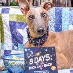 """Kuiper poses with the DVD of """"8 Days to the Moon and Back"""" and a bowl of popcorn."""