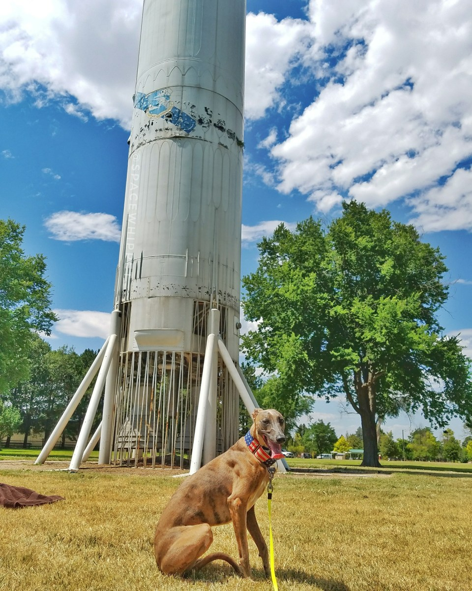 Kuiper poses with a Titan I rocket.