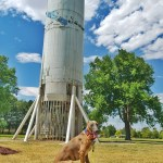 Kuiper poses with a Titan I rocket.