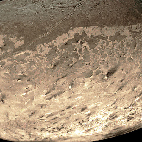 A picture of Neptune's moon, Triton, taken by Voyager 2 on its flyby