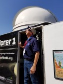 Richard Stember checks the progress of the eclipse from the door of the Mobile Observatory
