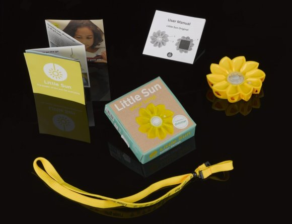 Sunflower-shaped light and packaging on a black background