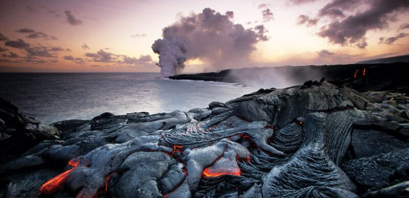 hot, orange lava on the edge of the sea