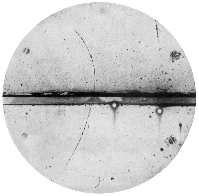 black and white image of a particle track cloud chamber