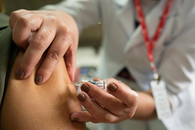 person getting CoronaVac vaccine