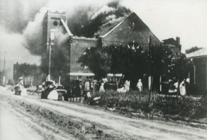 black and white image of Mt. Zion Baptist church on fire