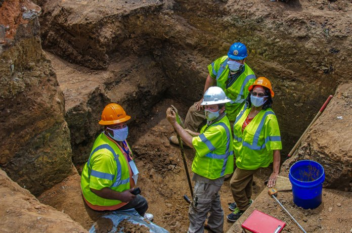 excavation team members in a trench at Oaklawn