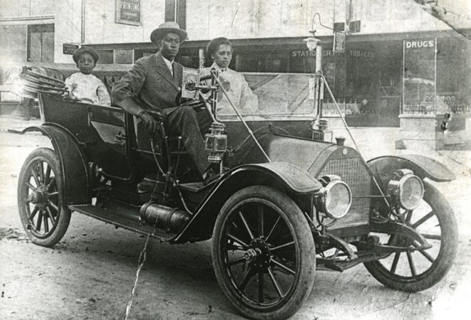 black and white image of the Williams family in a nice car