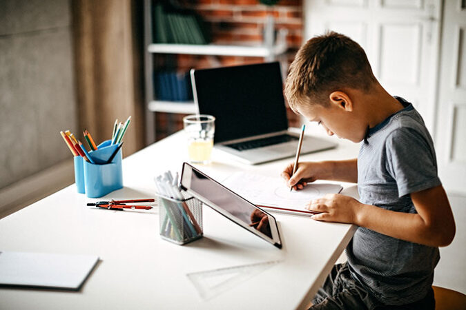 a boy studying at a table
