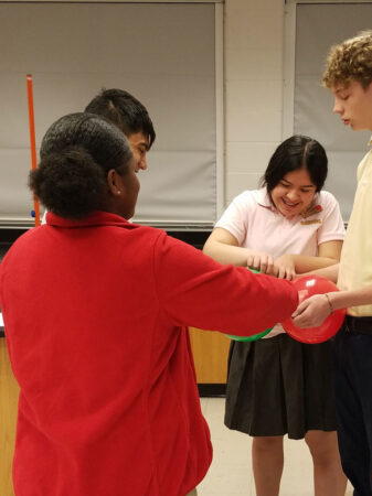 students in a classroom desiging balloon rockets