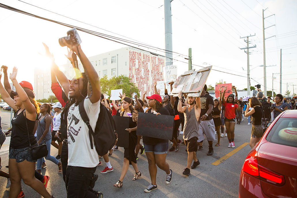 a photo of protesters marching in a Black Lives Matter march