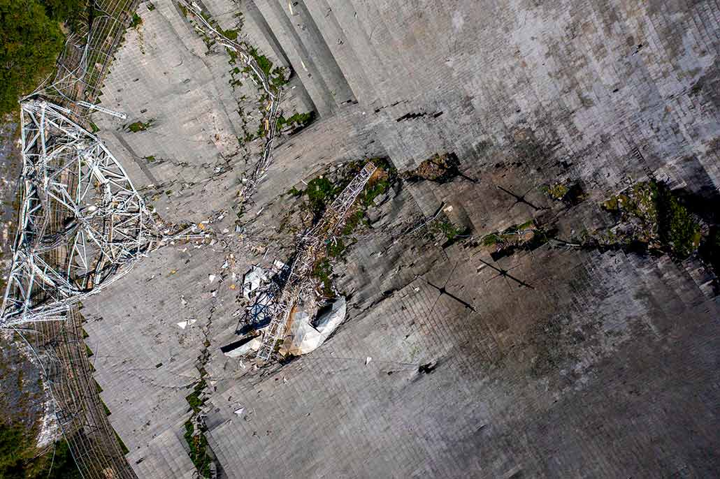 an aerial photo showing Arecibo's shattered dish