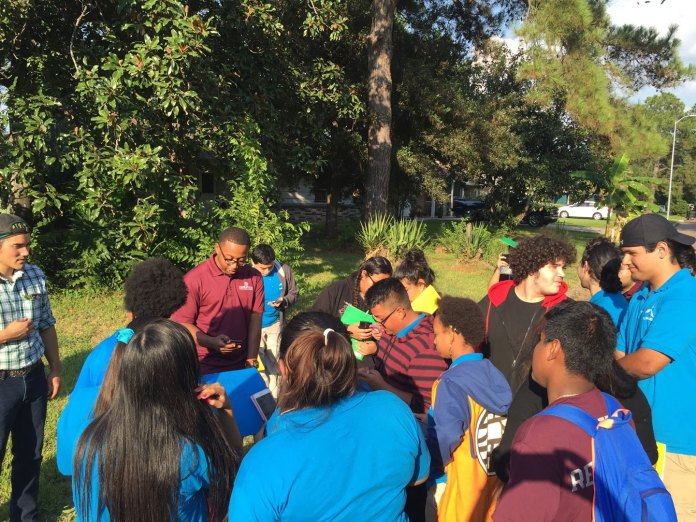 high school students who study storm water gather