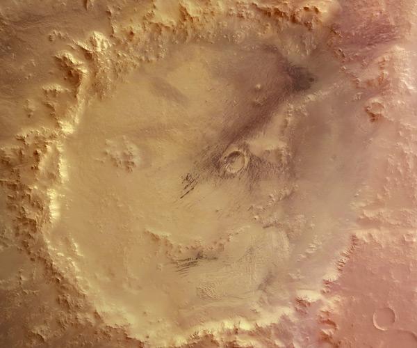 Zoals gezegd maakte de Mars Express heel wat mooie beelden van Mars. De foto hierboven is hier een mooi voorbeeld van. U ziet een krater op Mars die veel wegheeft van een smiley. Afbeelding: ESA / DLR / FU Berlin (G. Neukum).