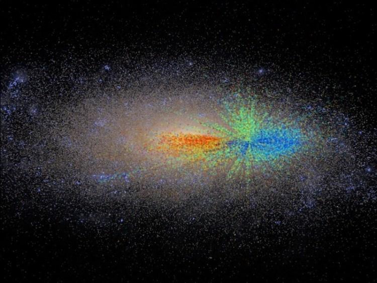 De jongste sterren zijn blauw, de oudste sterren zijn rood en de sterren van middelbare leeftijd zijn groen. Afbeelding: M. Ness / G Stinson / MPIA.