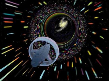 Een ruimtevaartuig duikt een wormgat in. Afbeelding: NASA.