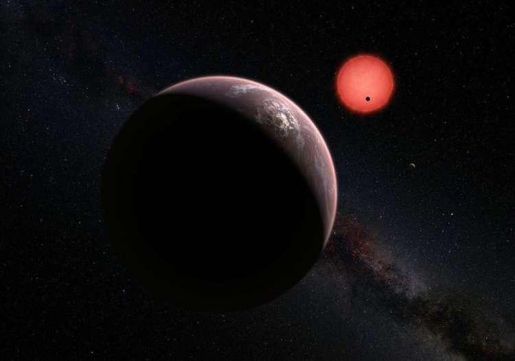 De ultrakoele dwerg en de drie planeten. Afbeelding: ESO / M. Kornmesser / N. Risinger.