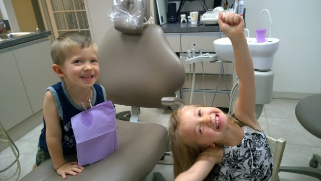 My 3-yr-old son & 4-yr-old daughter finishing another successful trip to the dentist.