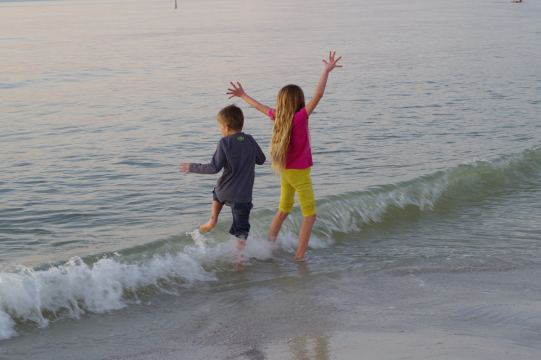 The kids jumping into the ocean at Clearwater Beach