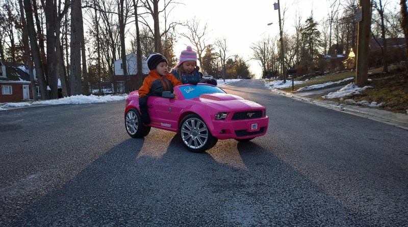 Taking a snowy sunset drive with her brother in the pink Barbie Mustang. Yes, I know, heresy for a Corvette enthusiast.