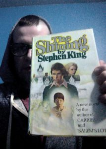 Eddie Generous holding his copy of The Shining