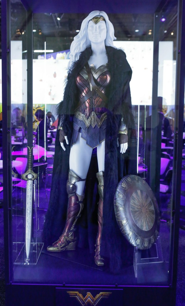 """The Wonder Woman costume worn by Gal Gadot in the highly-anticipated film """"Wonder Woman"""" is unveiled at the Warner Bros. Consumer Products booth at Licensing Expo 2016 on Tuesday, June 21, 2016 in Las Vegas. (Photo by Bizuayehu Tesfaye/Invision for Warner Bros. Consumer Products/AP Images)"""