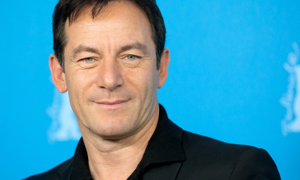 Actor Jason Isaacs poses for photographers at the photo call for the film Things People Do at the International Film Festival Berlinale in Berlin, Sunday, Feb. 9, 2014. (AP Photo/Axel Schmidt)